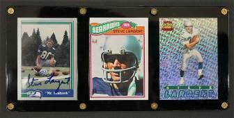 Steve Largent Framed Display of Signed Football Cards.