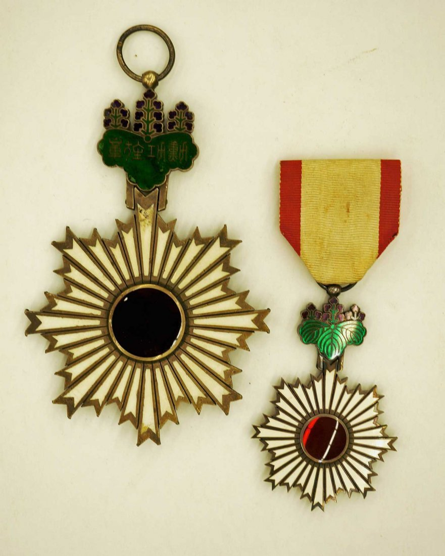 Japan Order of the Rising Sun Medals (2). Larger of the - 2