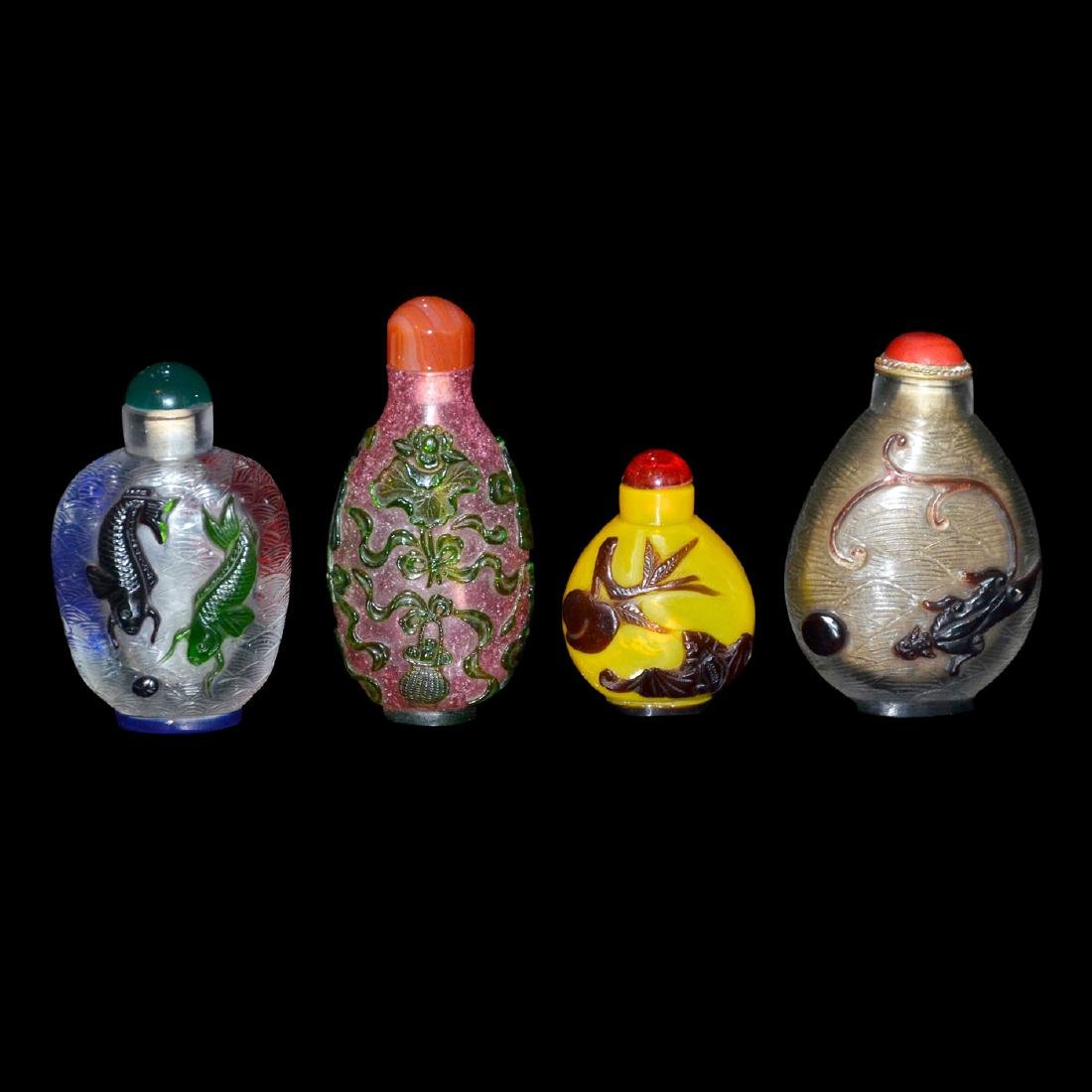 Qing, A Group of Four Overlay Snuff Bottles