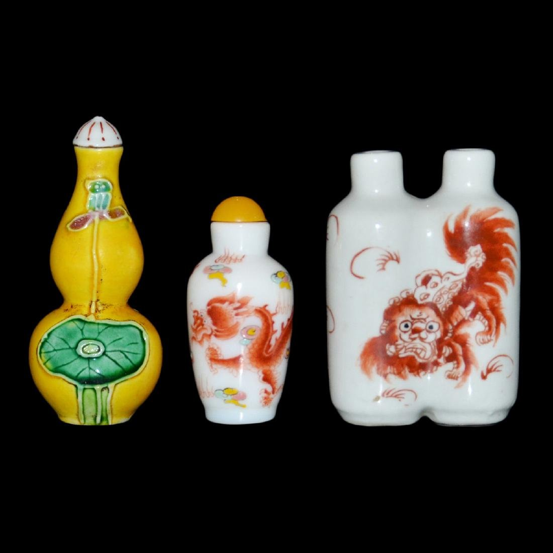 A Yellow Glazed Double-Gourd Snuff Bottles; Two Qilin