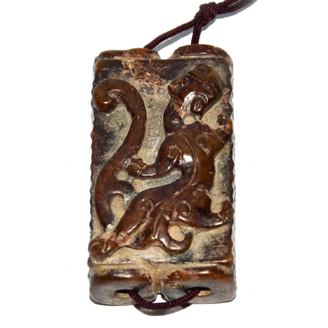 A Small Archaistic Relief Carved Qilin Twin-linked Jade