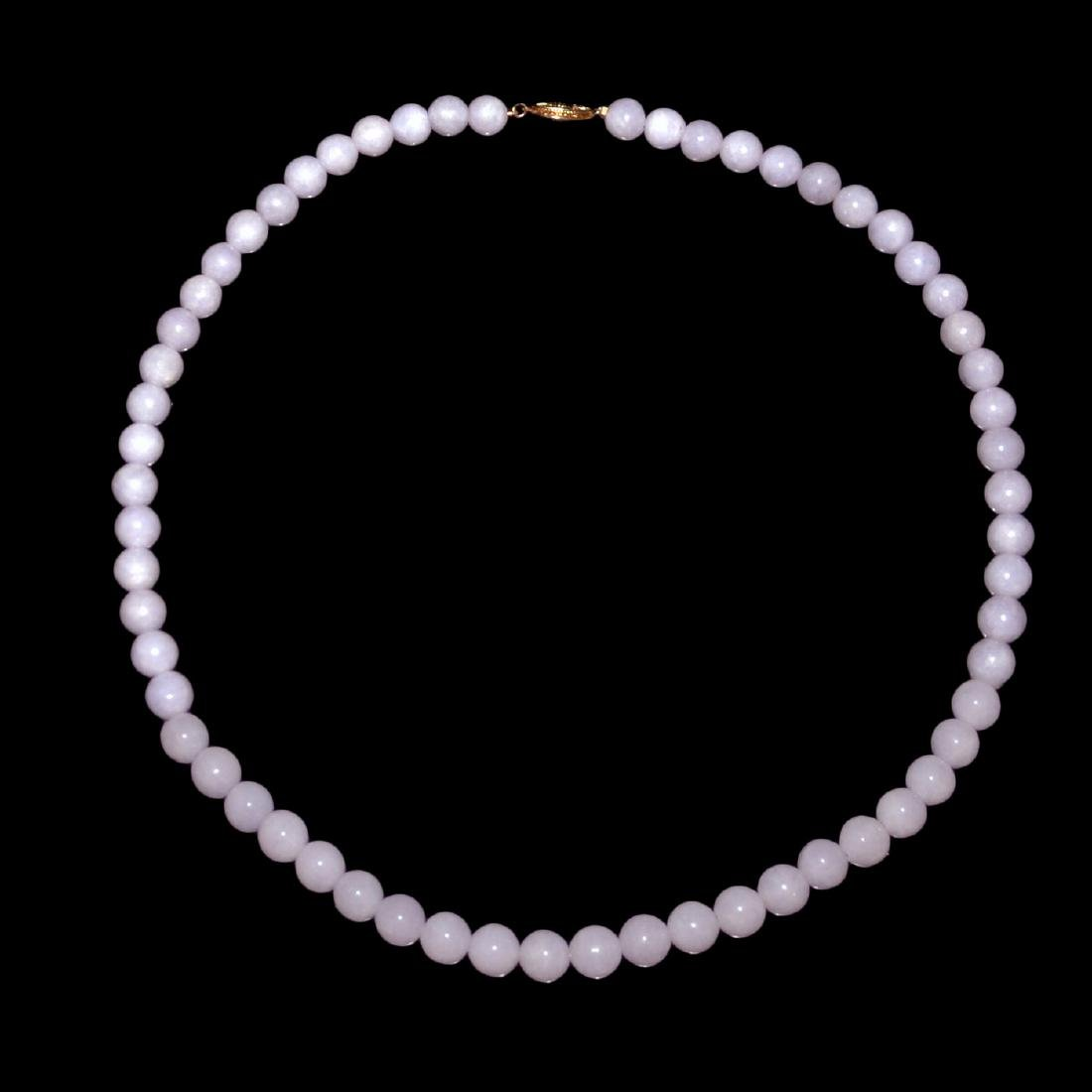 A Jadeite Lavender Bead Necklace