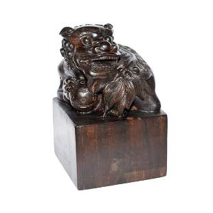 Qing, A Zitan Carved Seal with Buddhist Lion Playing