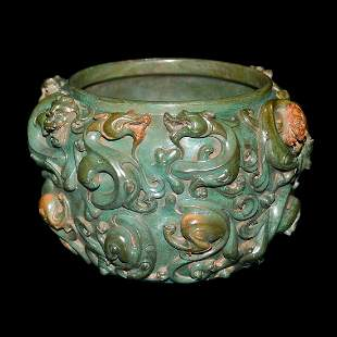 Qing, A Finely Carved Turquoise Nine-Chilong Washer