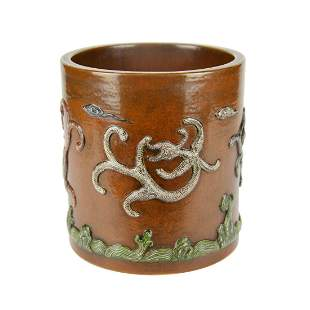 Qing, A Fine Brown Glazed Relief Carved Qilin Brush Pot