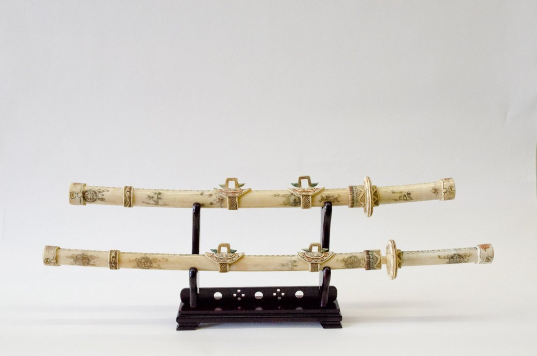 """Hand carved japanese bone swords on a wooden stand. 36"""""""