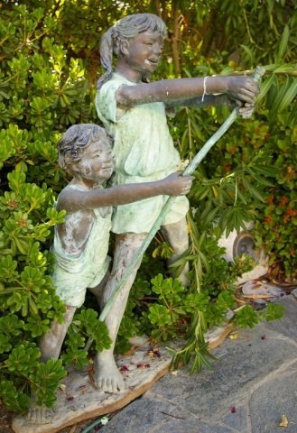 Life Size Bronze Sculpture of Two Kids Holding A H