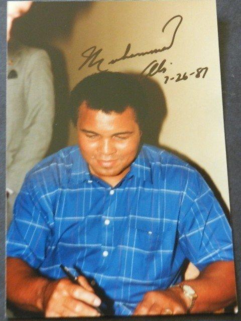 76: Signed Muhammad Ali Photo