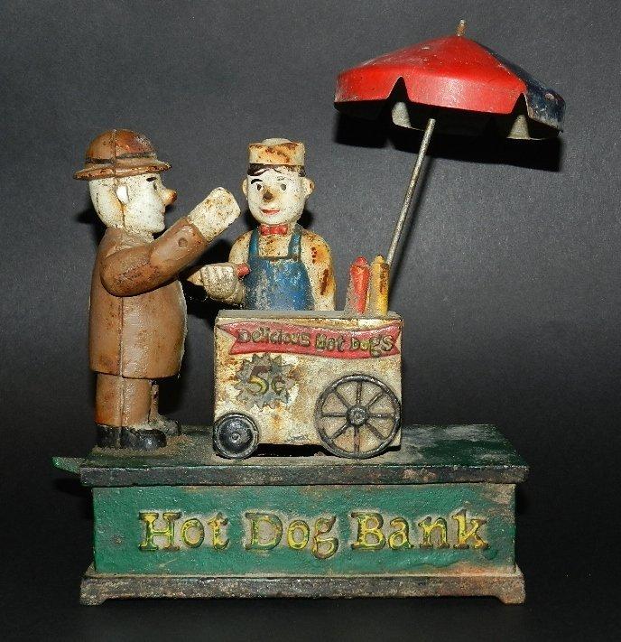 77: Early Cast Iron Hot Dog Mechanical Bank