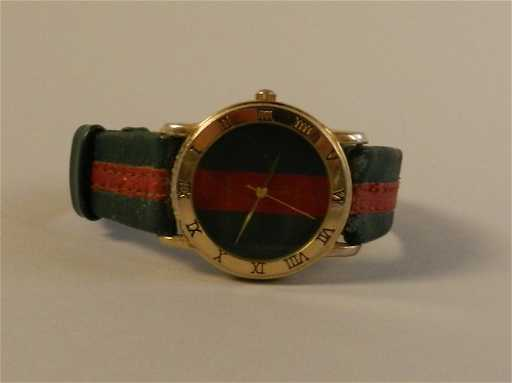9d1cffcd218 Vintage Men s Leather Gucci Watch. placeholder
