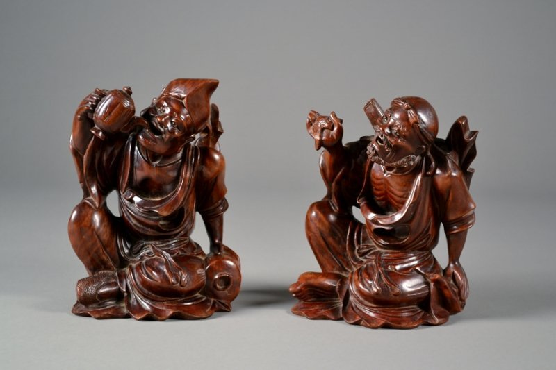 1: Pair of Finely Carved Wooden Figures depicting man d