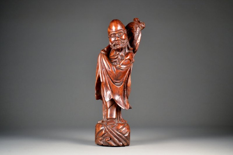 18: Finely Carved Hardwood Figure of Damu.  Nice patina