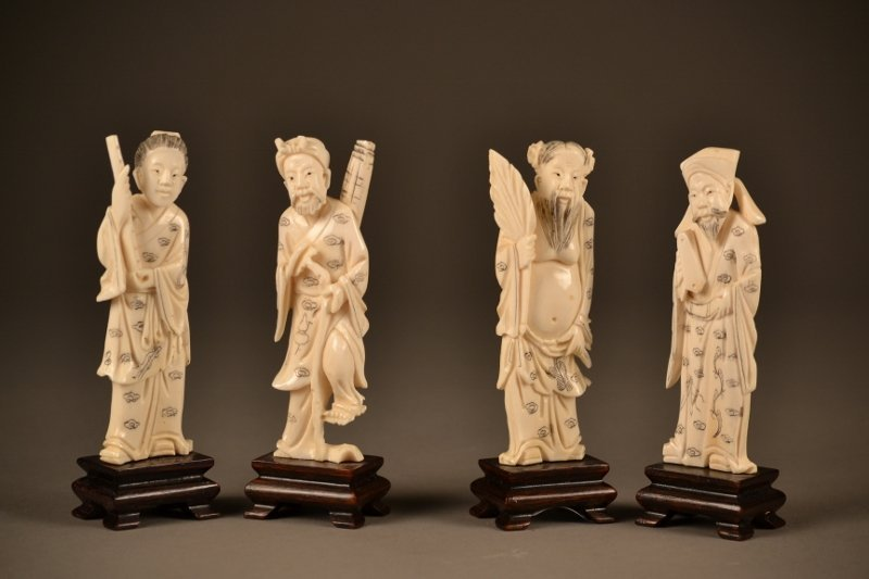 38: Set of 4 Ornate Ivory Carved Figures on Wooden Stan
