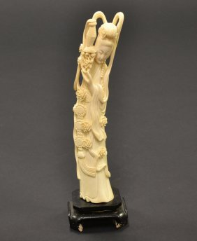 Finely Carved Ivory Figurine Of Lady On Wood Stand.