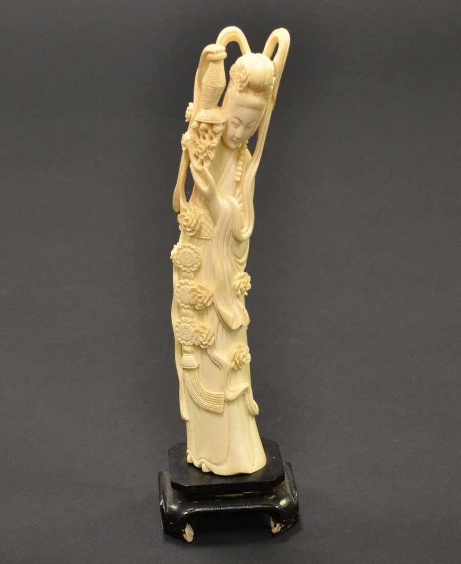 39: Finely Carved Ivory Figurine of Lady on Wood Stand.