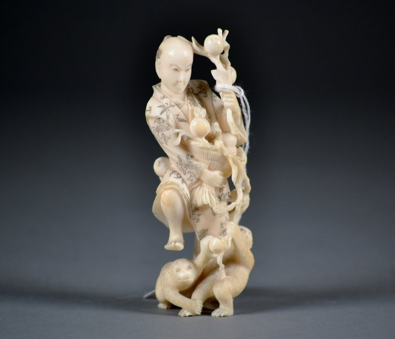 45: Finely Carved Ivory Figure of Man and Monkeys.