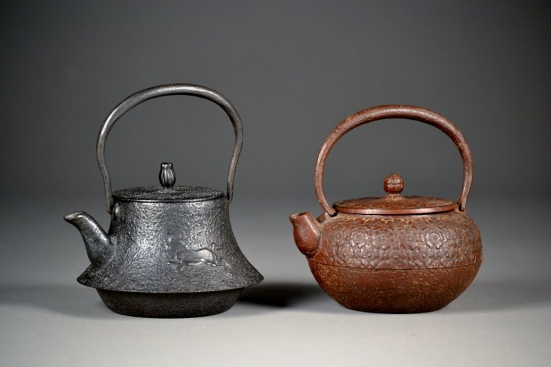 48: Two Iron Teapots