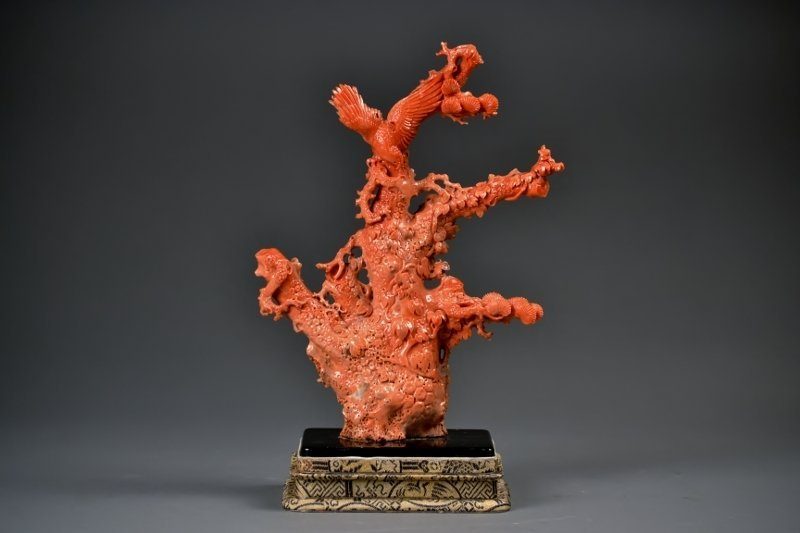 80: Carved Coral Sculpture with Eagle perched on a tree
