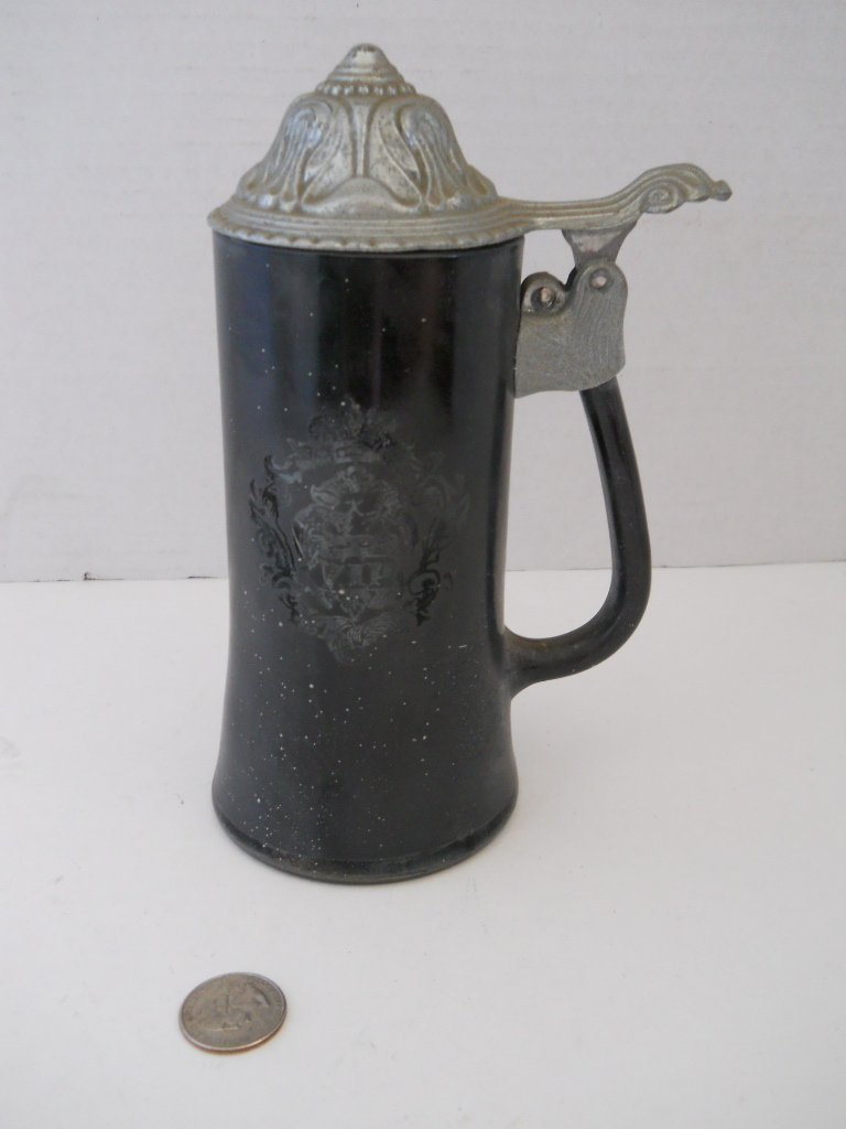34: BLACK STEIN WITH PEWTER LID,MARKED