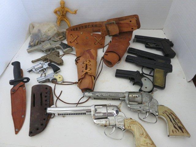 179: VINTAGE TOY GUNS /GUN HOLSTERS/KNIFE LOT