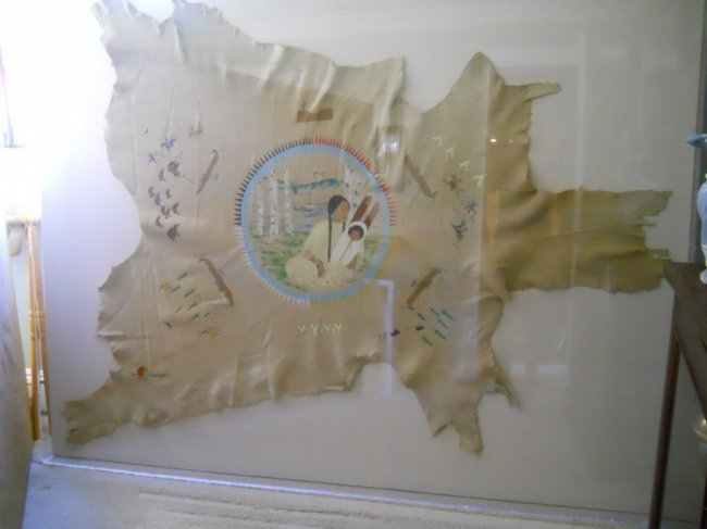201: DEER HIDE PAINTING MOTHER AND CHILD, SIGNED SACAGA