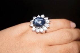18: 14KT WHITE GOLD STAR SAPPHIRE AND DIAMOND RING
