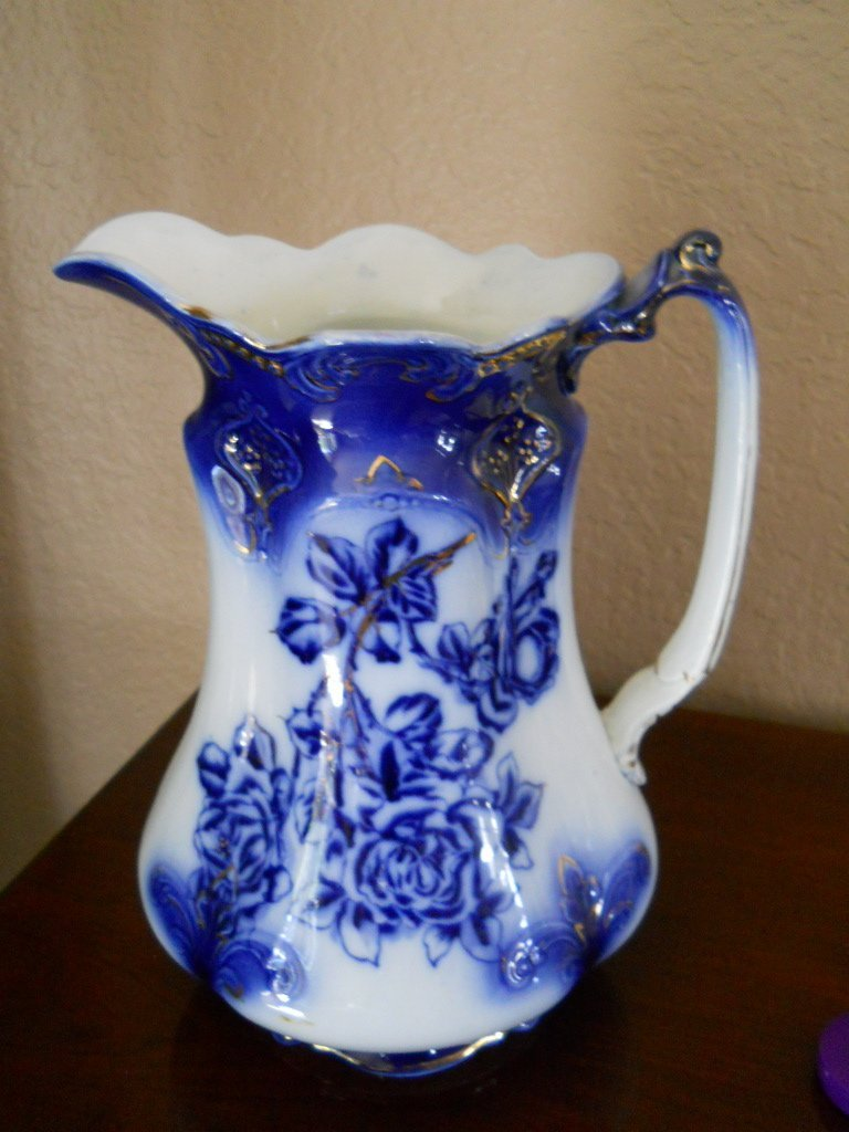 19: ANTIQUE FLOW BLUE WATER PITCHER,11""