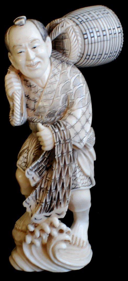 19: Japanese carved scrimshaw figurine of a man