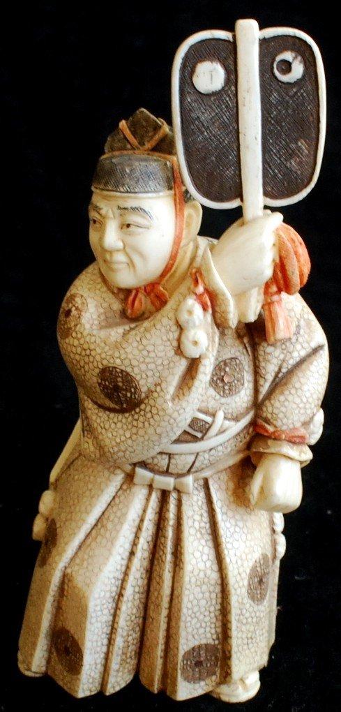 23: Japanese carved scrimshaw figurine of a man