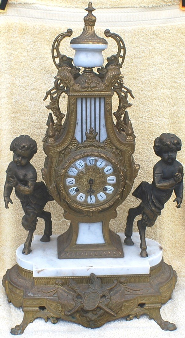 204: Bronze and marble clock and 2 candelabras with che