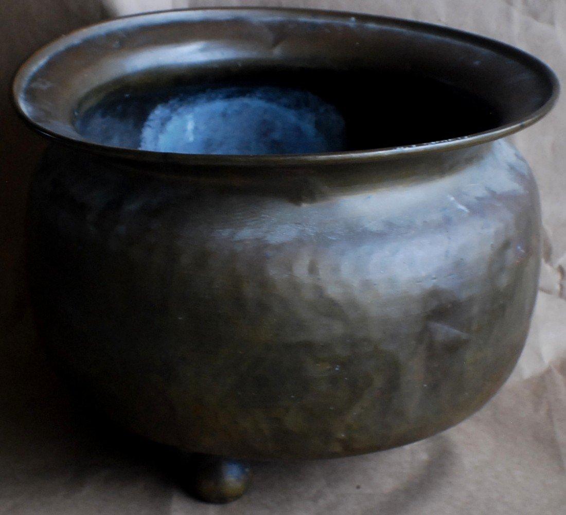 8: Brass footed pot