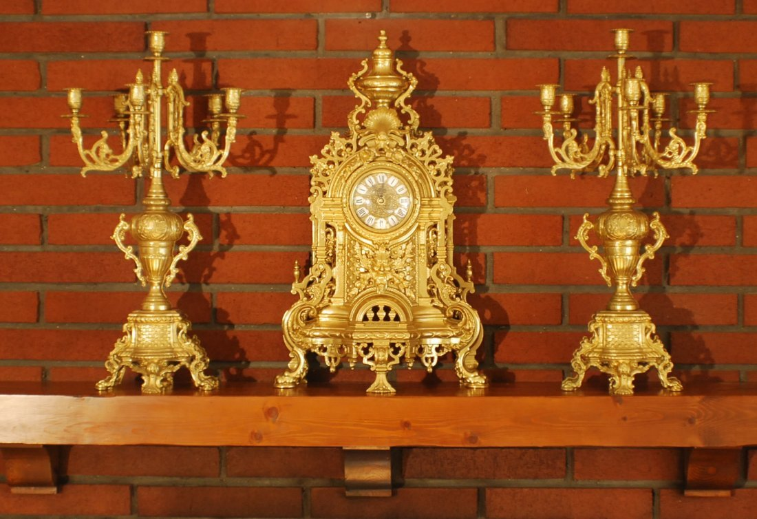 1: Brass  clock and pair of candelabras