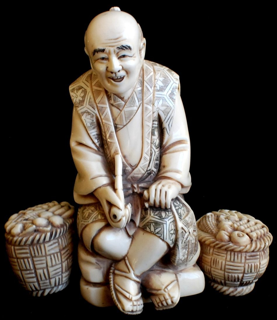 20: Japanese carved scrimshaw figurine, Man with two bu