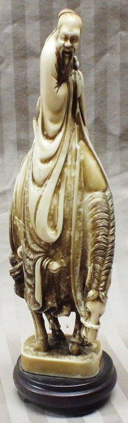 22: Japanese carved scrimshaw figurine, old  man on a h