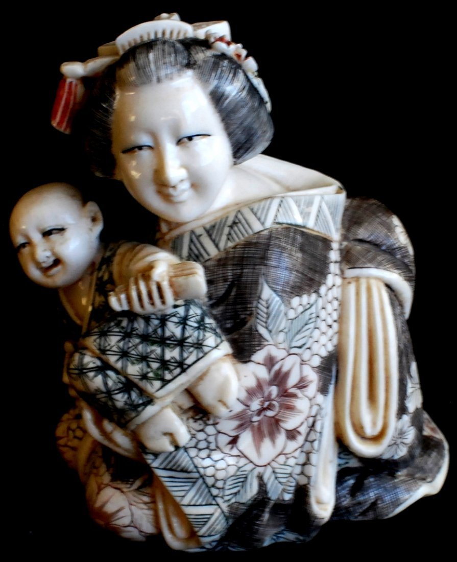 21: Japanese carved scrimshaw figurine woman with child