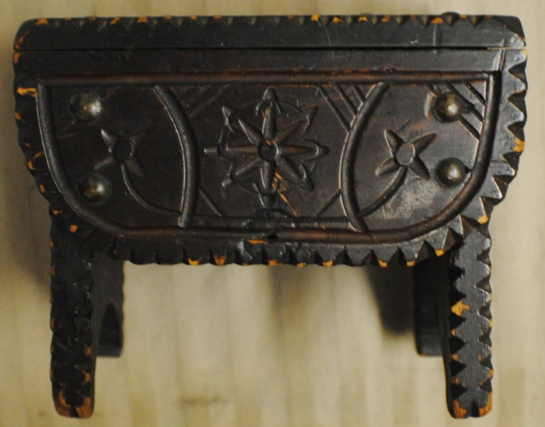 4: Early carved wooden bank