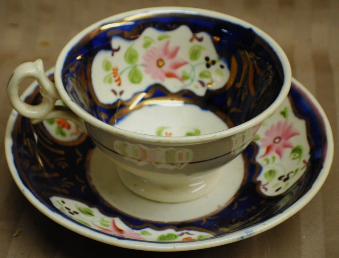 6: Early hand painted cup and saucer, probably Russian