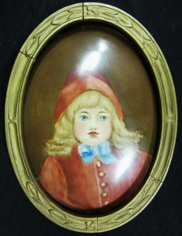 17: KPM Oval porcelain plaque, portrait of a child.