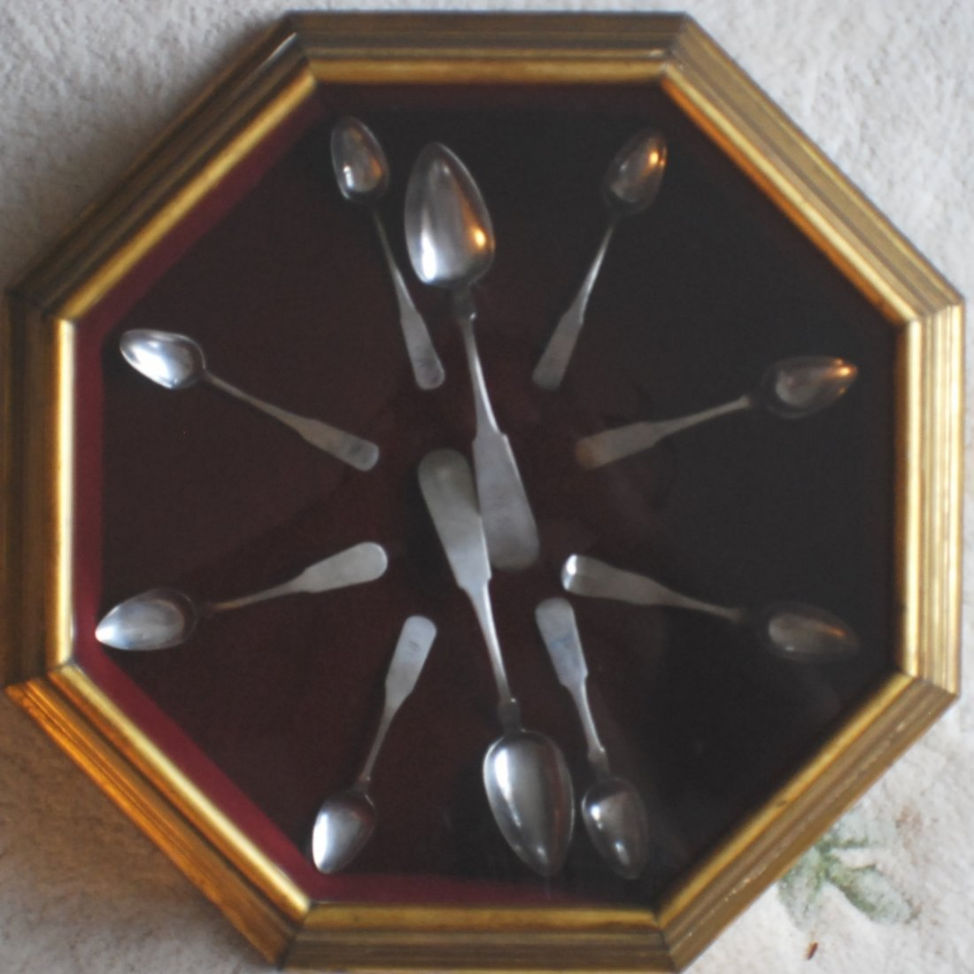 6: Octagonal Display with 10 pcs. 1800's Coin Silver sp