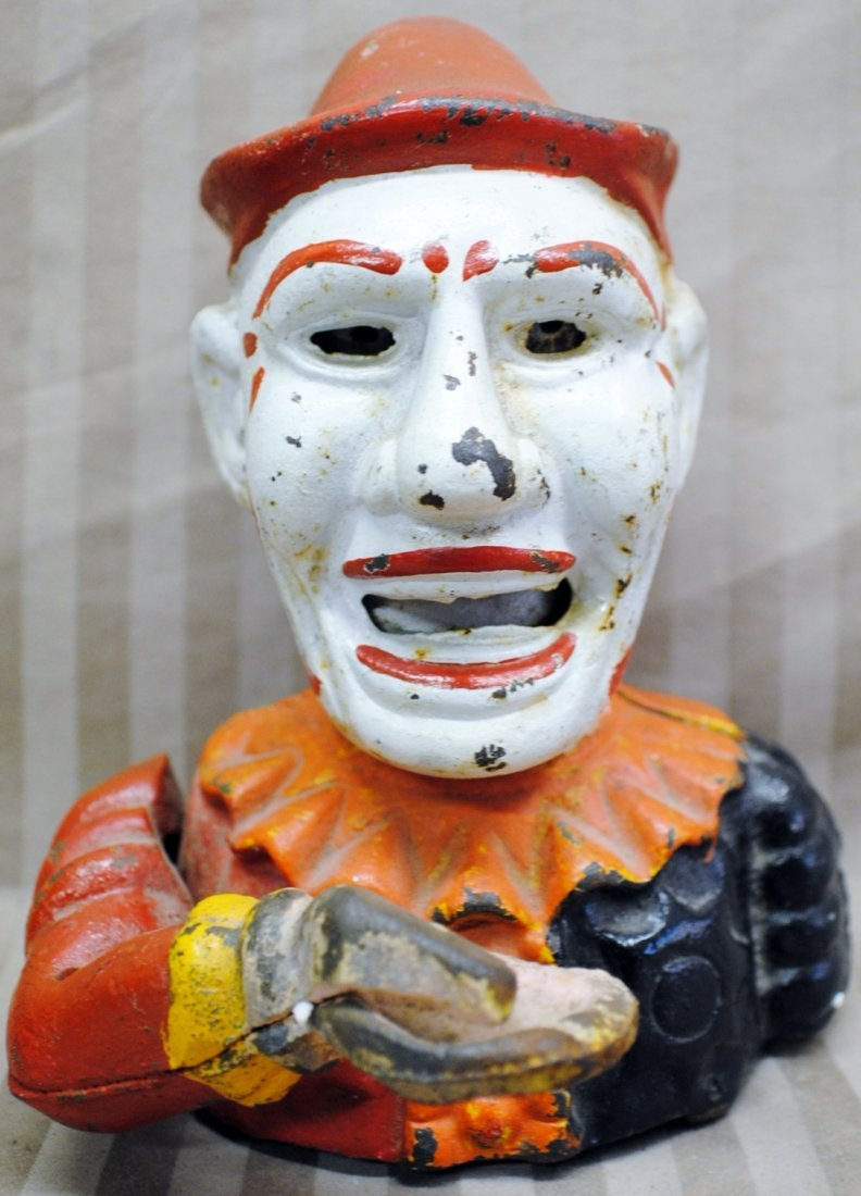 Metal cast Clown mechanical bank