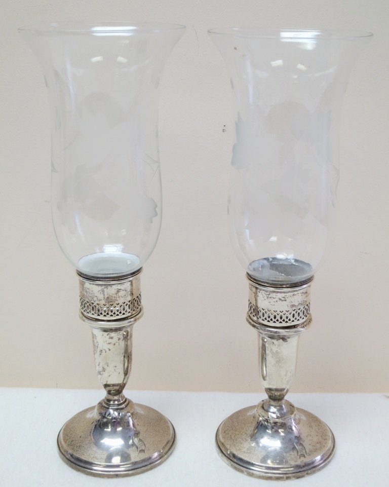 Pair of sterling silver candlesticks with glass shades