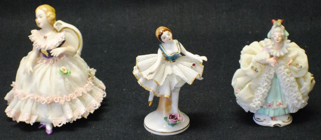 Collection of three Meissen lace porcelain figurines.