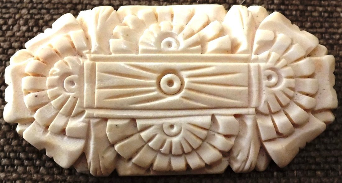 Carved ivory broach