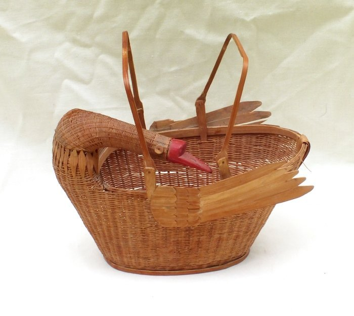 Vintage woven egg basket with bird