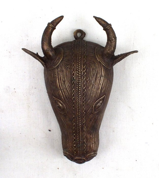 Carved bronze cow head
