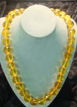 1021: NECKLACE, FACETED CLEAR AMBER BEADS