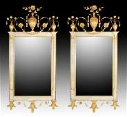 A PAIR OF NORTH ITALIAN GILTWOOD MIRRORS