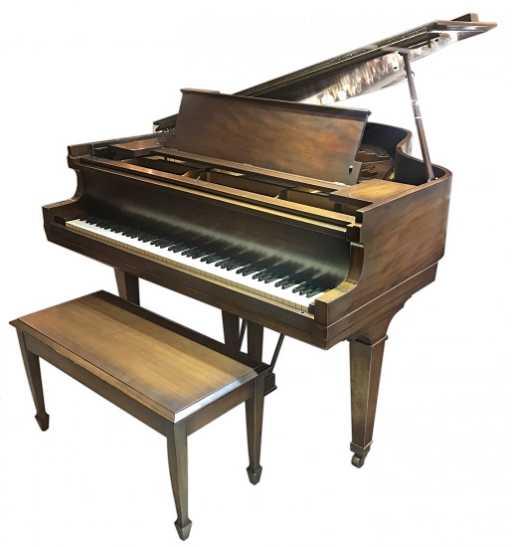 A Hardman Peck Mahagony Baby Grand Piano
