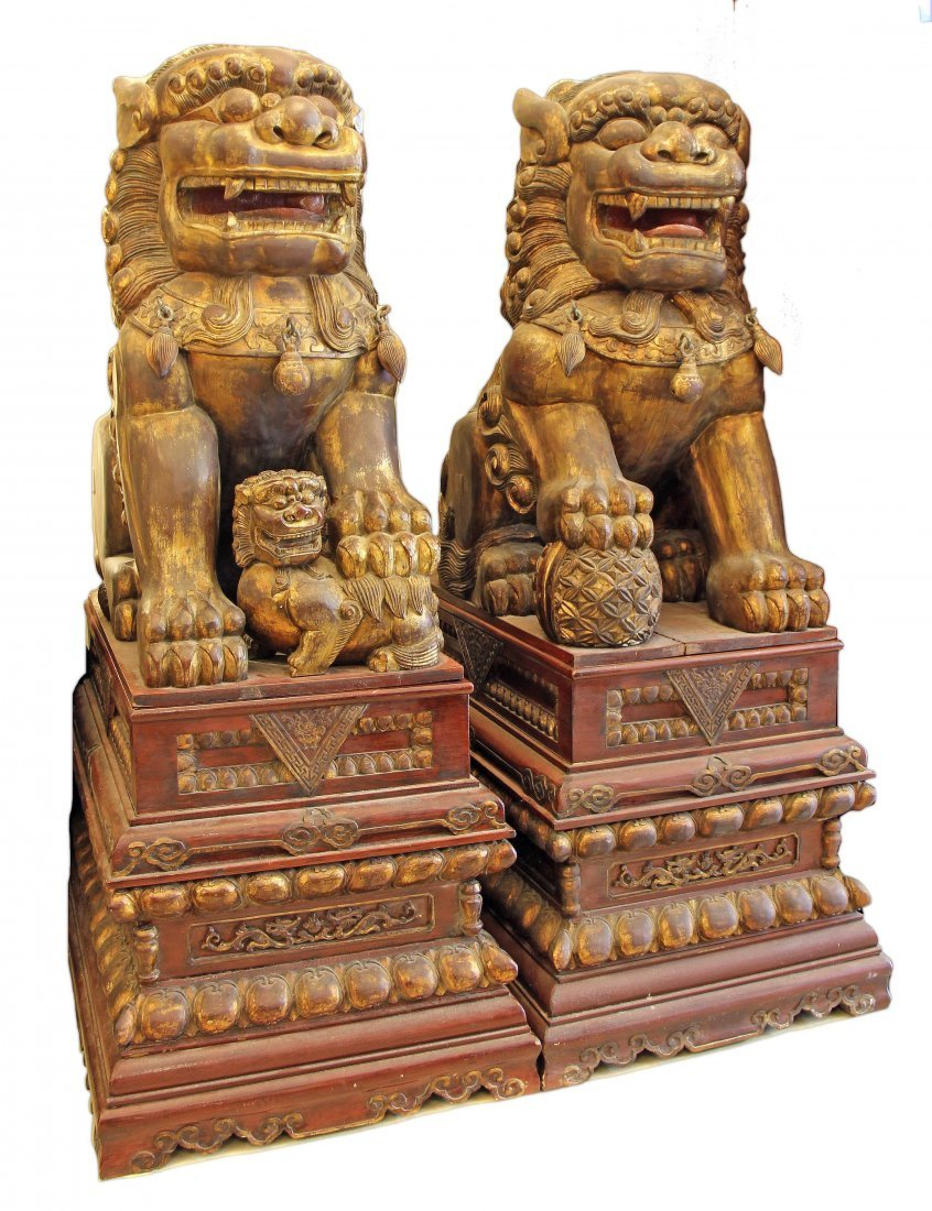A MASSIVE PAIR OF GILT WOOD FIGURES OF FOO DOGS
