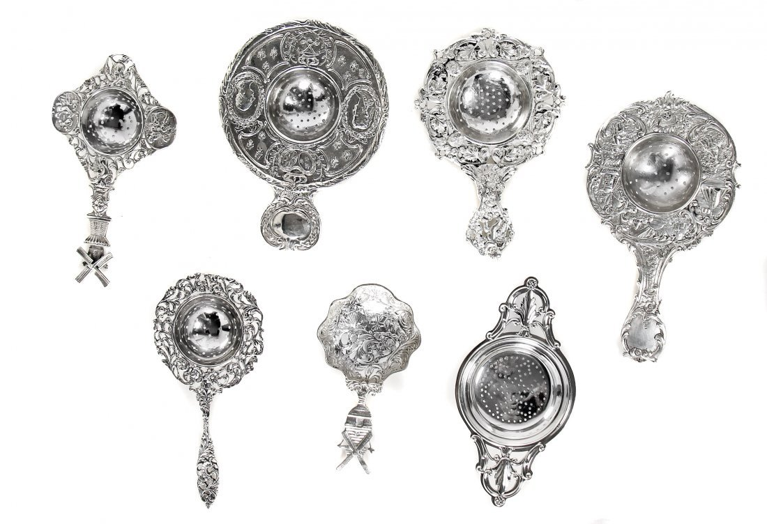 SEVEN VINTAGE SILVER PLATED TEA STRAINERS